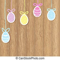 Easter eggs on a brown wooden background