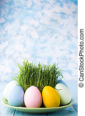 Easter eggs on a plate - Easter eggs with grass served on...