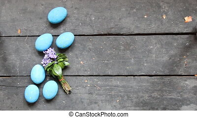 Easter eggs on a vintage background, copy space