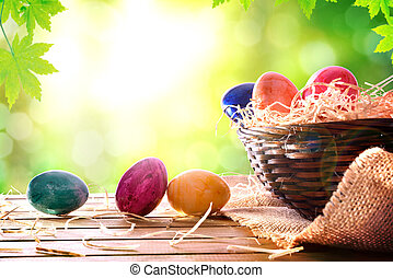 Easter eggs on a wooden table in nature front view