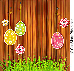 Easter eggs on a wooden wall