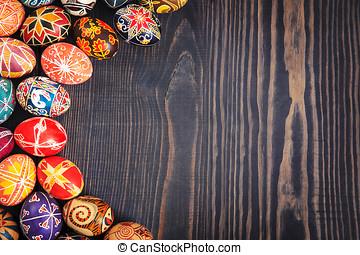 Easter eggs on dark wooden background.