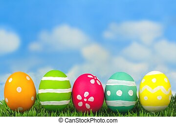 Easter eggs on grass with blue sky