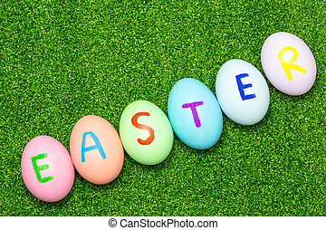 Easter eggs on green grass background