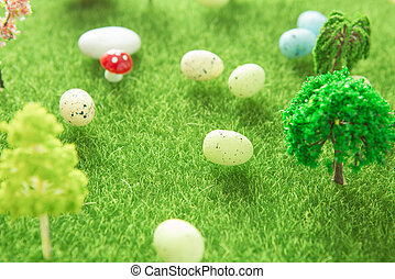 Easter eggs on green grass. Fairy tale