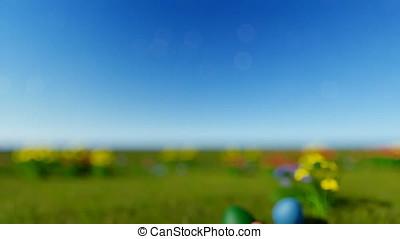 Easter eggs on green meadow over blue blurry sky, tilt