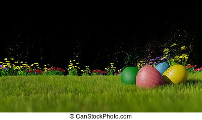 Easter eggs on green meadow, particles rising