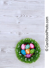 Easter eggs on grey wooden ground