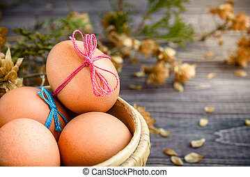 Easter eggs on rustic wooden backgroun
