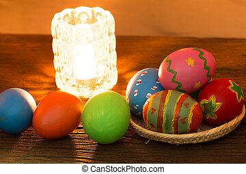 Easter eggs on the wood with lamp