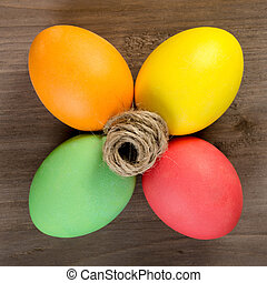 Easter eggs on the wooden backgroun