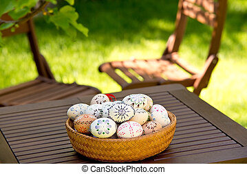 Easter Eggs On The Wooden Table In The Garden