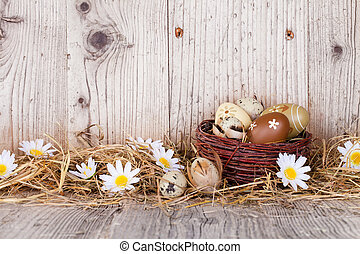 Easter still life with traditional decorative eggs in straw