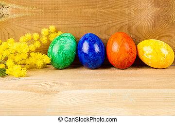 Easter eggs on wood
