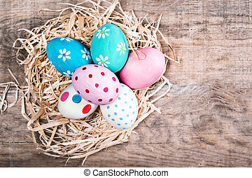 Easter eggs on wooden background with copyspace. Happy Easter!