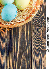 Easter eggs on wooden background with copyspace