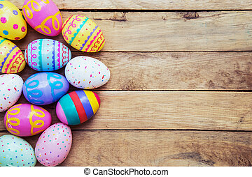 Easter eggs on wooden background with space