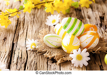 Easter eggs on wooden surface - Easter eggs in nest with...