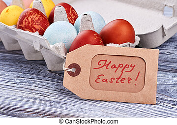 Easter eggs on wooden surface.