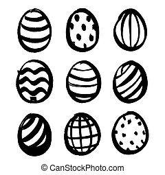 Easter eggs painted with strokes of black paint isolated on a white background