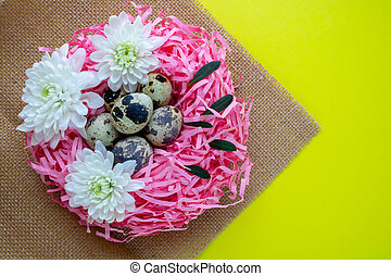 Easter eggs. Quail eggs in a decorative pink nest . Copy space. The concept of Easter celebration.