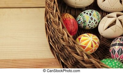 Easter eggs rolling around text Happy Easter