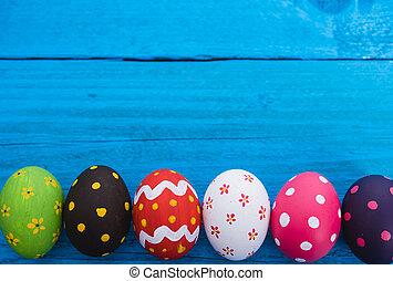 Easter eggs top view on blue wooden background