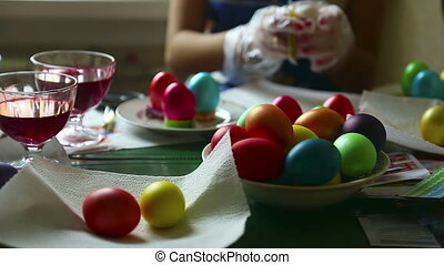 Easter eggs - Two women coloring easter eggs.