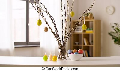 easter eggs, willow and candles burning at home - easter, ...