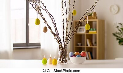 easter eggs, willow and candles burning at home - easter,...