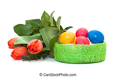 Easter eggs with a bouquet of tulips