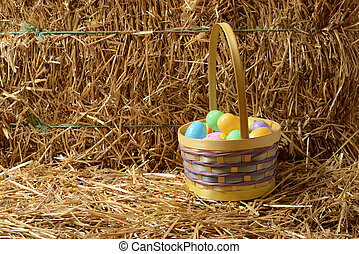 Easter eggs with basket and straw