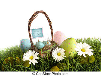 Easter eggs with  basket in the grass