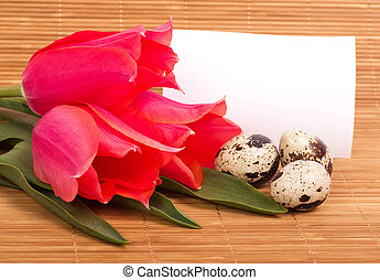 Easter eggs with bouquet pink tulip