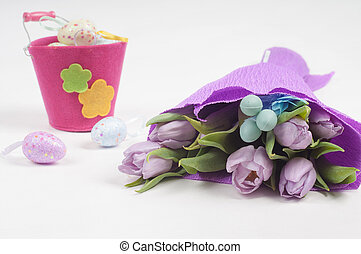 Easter eggs with bucket and tulips