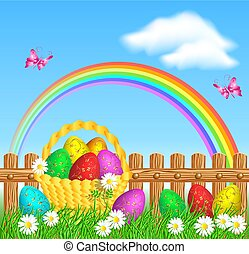 Easter eggs with golden ornament on grass and basket with easter eggs against wooden fence and rainbow