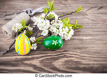 Easter eggs with spring flowers blooming tree
