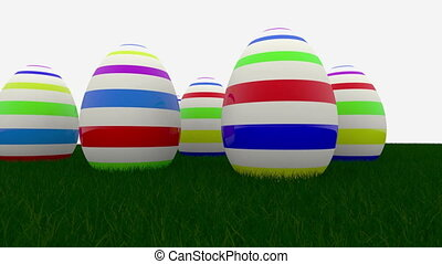 Easter eggs with stripes on green