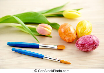 easter eggs with tulips and paintbrush