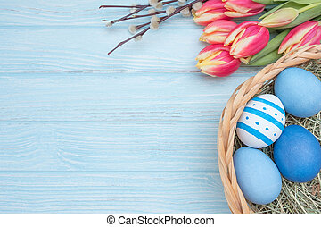 Easter eggs with tulips and willow