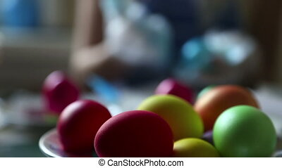 Easter eggs - Woman coloring easter eggs.