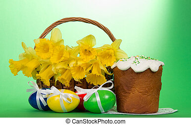 Easter elements composition - Flowers in a basket, eggs with...