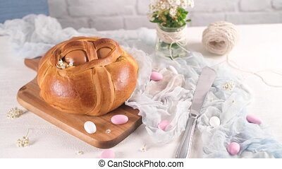 Easter folar with egg on wooden table top.
