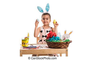 Easter girl showing eggs