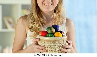 Easter girl - Pretty blond girl holding a basket full of...