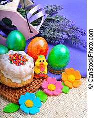 Easter green eggs with flowers, cake and chicken.