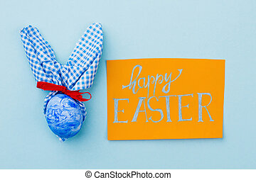 Easter greeting card on blue background.