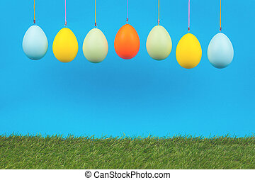 Easter greeting card with dyed eggs garland and grass