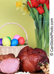 Easter ham and eggs - Easter theme setting with a basket of...