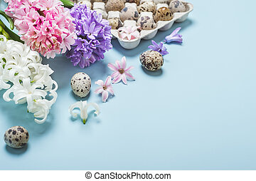 Easter Holiday Blue background. Quail eggs and hyacinth flowers